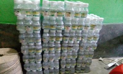নওগাঁ কারখানায় লাইসেন্সবিহীন নারিকেল তেল