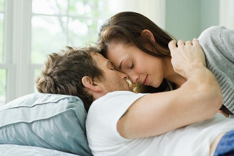 Intimate couple on bed